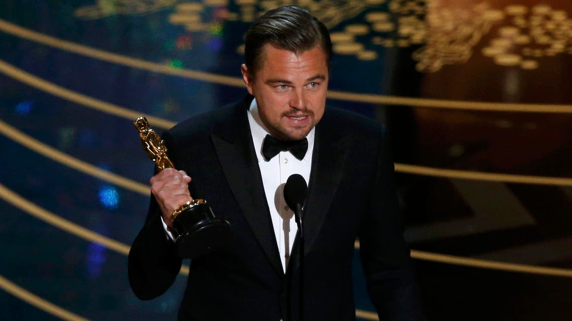 """Leonardo DiCaprio holds the Oscar for Best Actor for the movie """"The Revenant"""" at the 88th Academy Awards in Hollywood"""