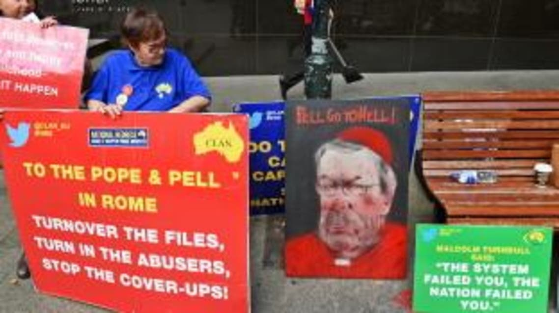 Protesters hold placards outside the Royal Commission into Institutional Responses to Child Sexual Abuse in Sydney on February 29, 2016, as Australia's Cardinal George Pell gave evidence via video-link from a hotel in Rome to the Royal Commission rather than appearing in person as he has a heart condition. (AFP)