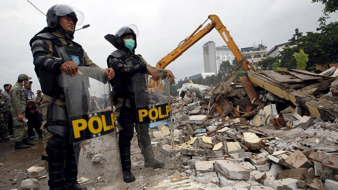 Civil service police watch the demolition of Kalijodo red-light district in Jakarta, Indonesia. (Reuters)
