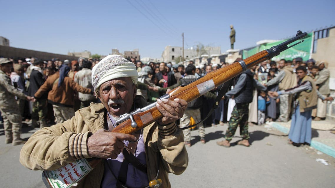 A Houthi militant carries his weapon during the funerals of Lutf al-Quhum, a prominent pro-Houthi religious singer, and a Houthi fighter, in Yemen's capital Sanaa, February 18, 2016. (Reuters)