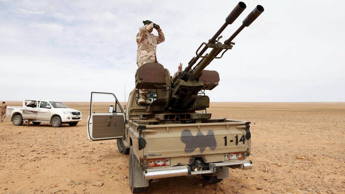 A Libyan soldier looks through binoculars at Wadi Bey, where troops are manning outposts, west of the Islamic State-controlled city of Sirte. (File photo: Reuters)