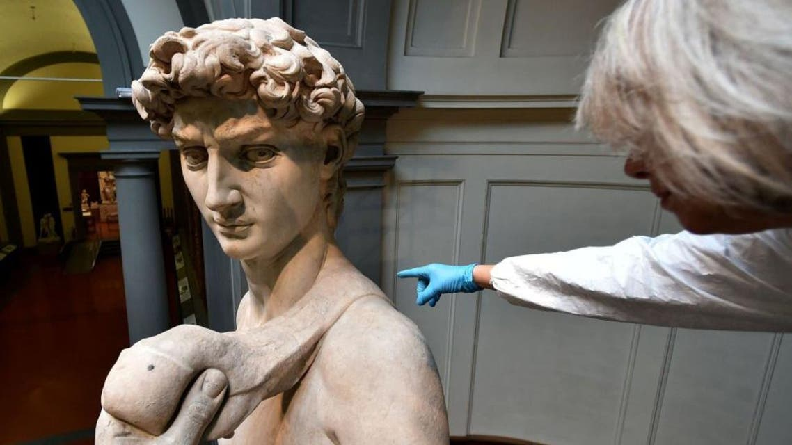 An Italian restorer from the Friends of Florence Association cleans Michelangelo's David, one of the world's most famous statues, at the Galleria dell'Accademia in Florence. (AFP)