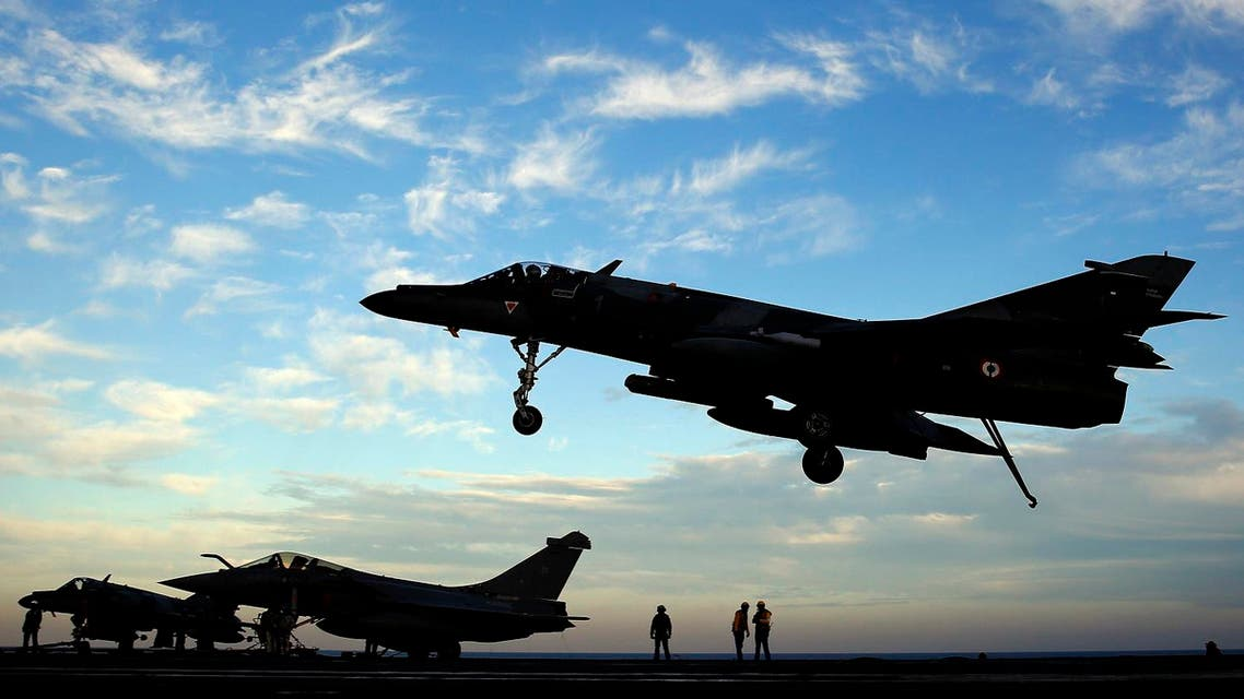 A Super Etendard fighter jet lands after a mission, on France's flagship Charles de Gaulle aircraft carrier in the Arabian Gulf. (File photo: AP)