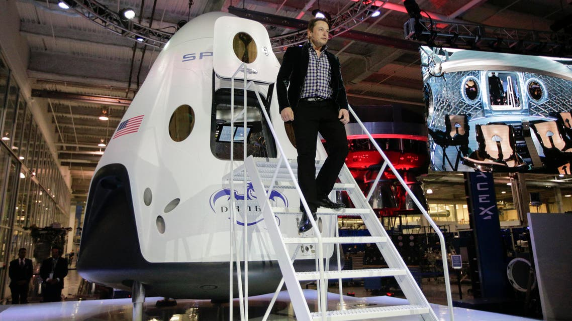 Elon Musk, CEO and CTO of SpaceX, walks down the steps while introducing the SpaceX Dragon V2 spaceship at the headquarters on Thursday, May 29, 2014, in Hawthorne, Calif. (AP)