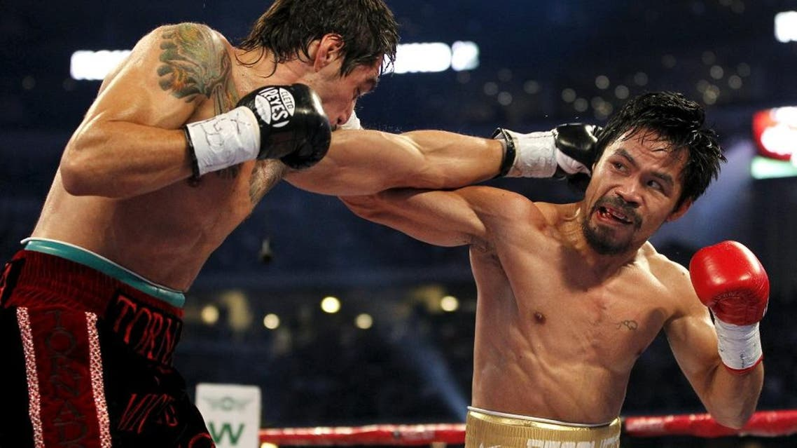 """Manny Pacquiao (R) of the Philippines fights Antonio Margarito of Mexico during the second round of their 12-round WBC World Super Welterweight title boxing fight in Arlington, Texas in this November 13, 2010 file photo. Nike Inc, the world's largest sportswear maker, said it had ended its contract with Manny Pacquiao after the Filipino boxer described gays as """"worse than animals"""". Picture taken November 13, 2010. REUTERS/Mike Stone/Files"""