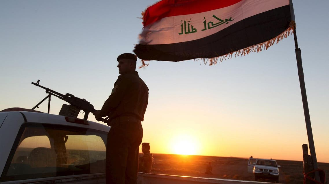 A member from the Iraqi security forces stands guard during a patrol at the border between Iraq and Saudi Arabia. (Reuters)