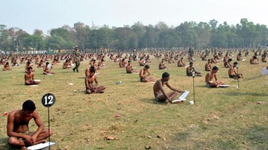 Images in the Indian Express showed dozens of men sitting cross-legged in a field clad only in underpants. (AFP)