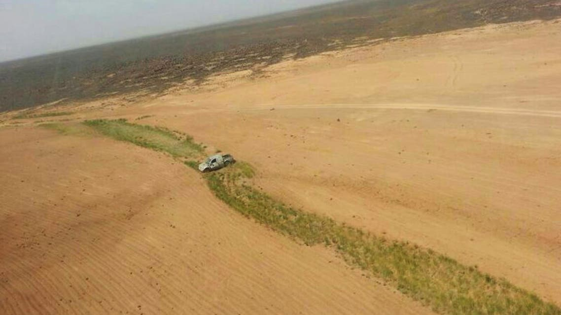This aerial photo shows a truck after a Jordanian air strike on a convoy at the border between Jordan and Syria on Wednesday, April 16, 2014. AP