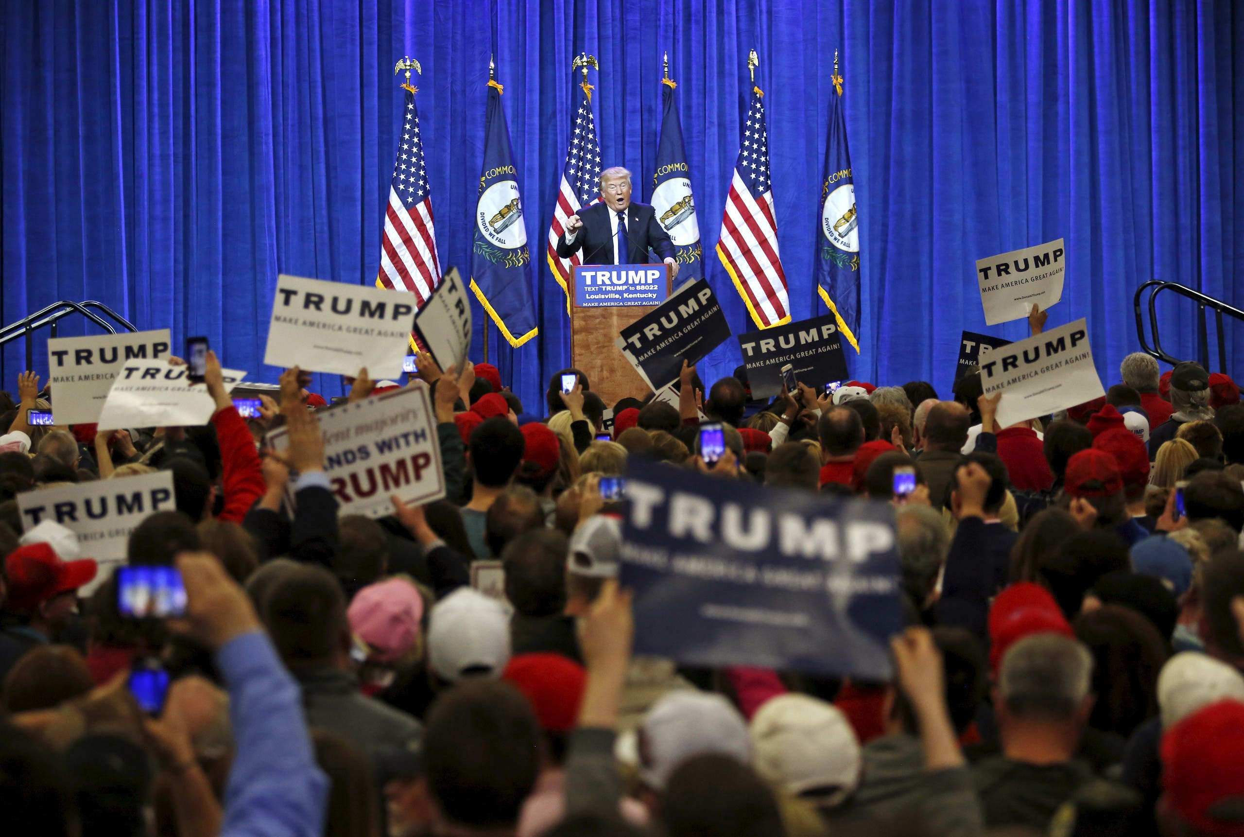 Republican U.S. presidential candidate Donald Trump speaks to supporters at a Super Tuesday campaign rally in Louisville, Kentucky March 1, 2016.