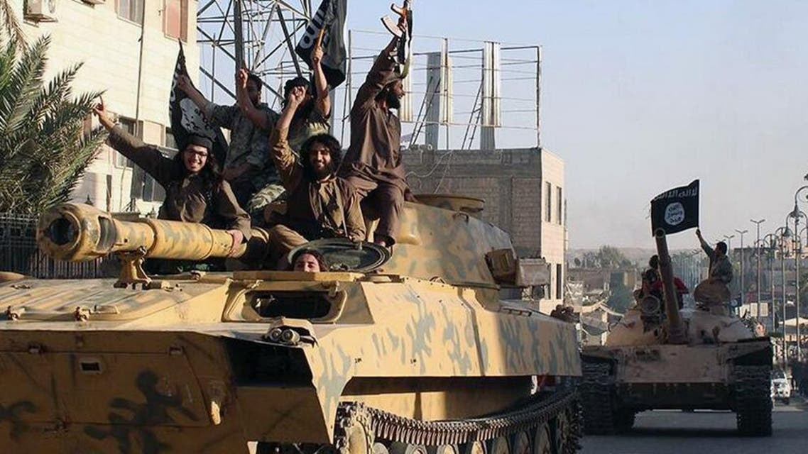 In this undated file image posted by the Raqqa Media Center, in Islamic State group-held territory, on Monday, June 30, 2014, which has been verified and is consistent with other AP reporting, fighters from the Islamic State group ride tanks during a parade in Raqqa, Syria. (Raqqa Media Center via AP, File)