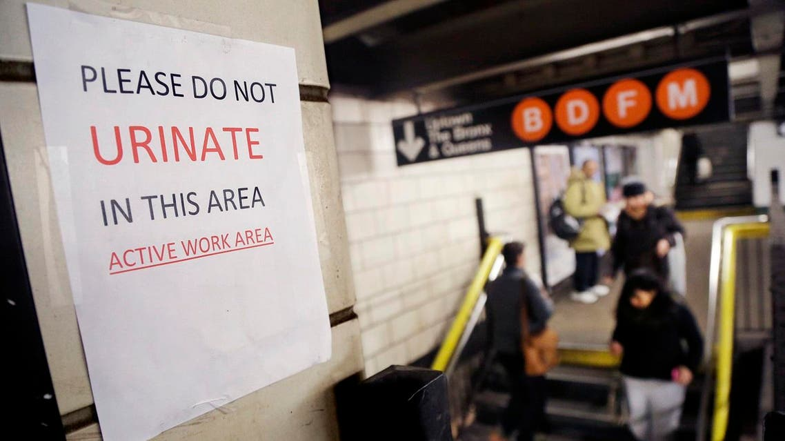 """A sign hangs in the West 4th Street subway station reads """"Please Do Not Urinate In This Area - Active Work Area."""" (AP)"""
