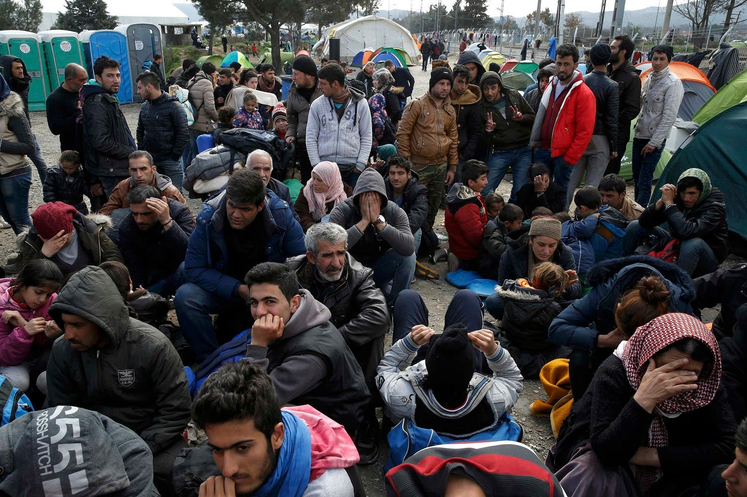 Migrants queue to receive travel papers near the Greek-Macedonian border, near the village of Idomeni, Greece March 2, 2016. REUTERS