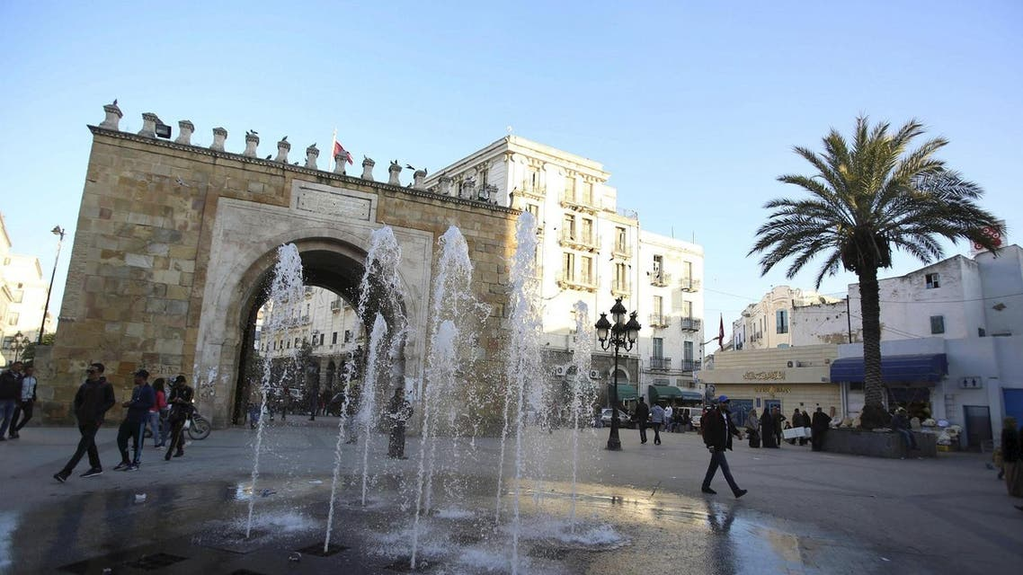 People walk past the arch of Bab el-Bhar, also known as the French gate, at the entrance of the medina district in Tunis, Tunisia February 3, 2016. REUTERS/Zoubeir Souissi