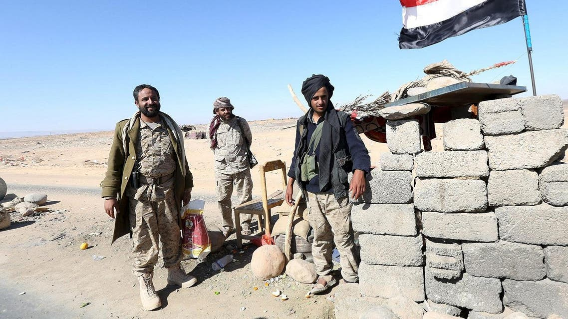 Pro-government army soldiers man a checkpoint on a road in Fardhat Nahm area. (Reuters)