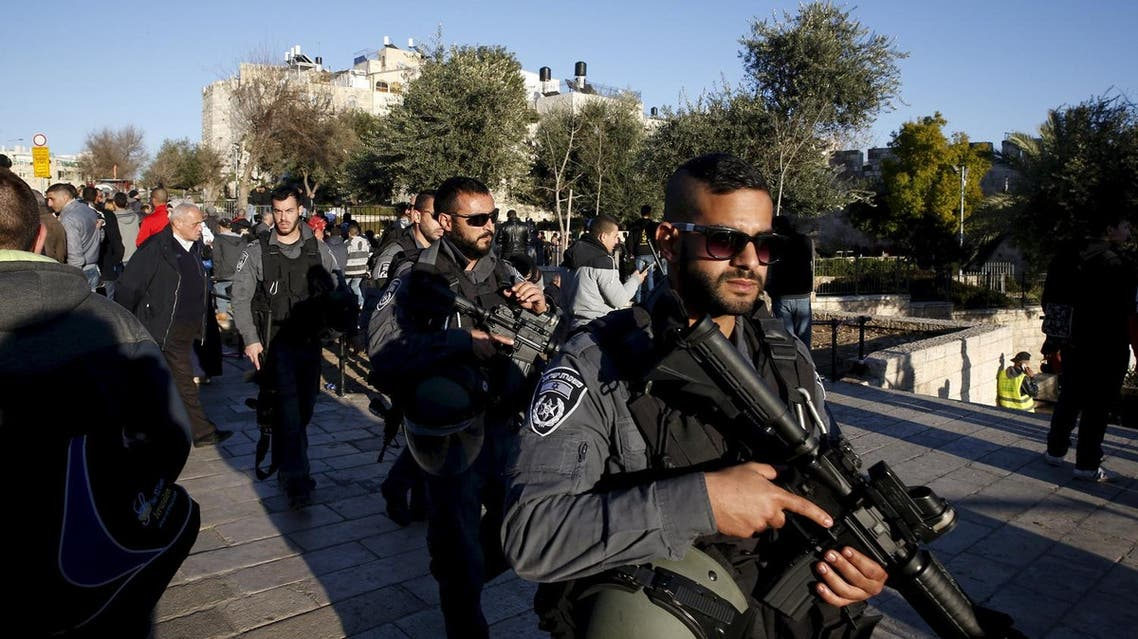 Israeli policemen patrol an area near the scene where three Palestinians were shot dead by Israeli police after carrying out what Israeli police spokesman said was a shooting and stabbing attack outside Damascus Gate to Jerusalem's Old City, in this February 3, 2016 file picture. REUTERS
