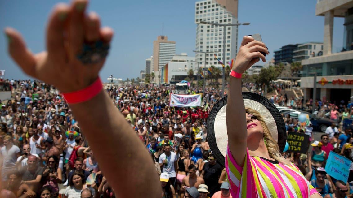 Israeli drag queens perform during the annual Gay Pride Parade on a street of Tel Aviv, Israel, Friday, June 13, 2014. AP