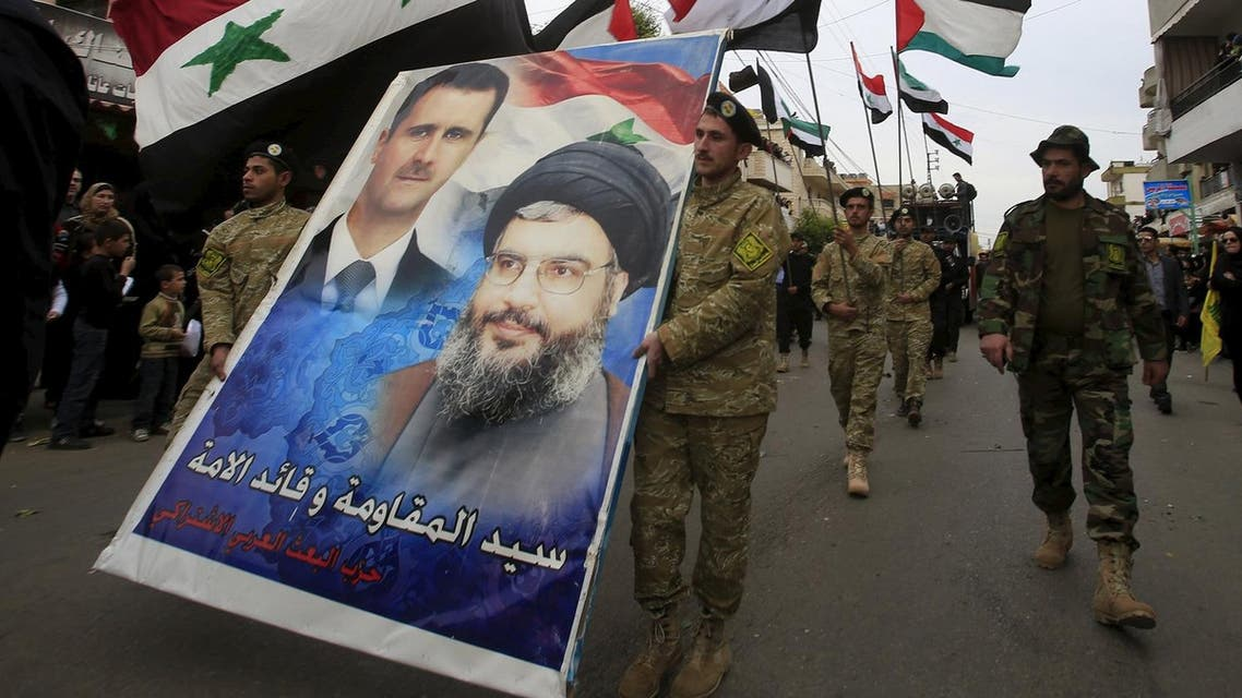 Members of the Arab Socialist Baath Party carry a picture depicting Syria's President Bashar al-Assad and Hezbollah leader Hassan Nasrallah. (Reuters)