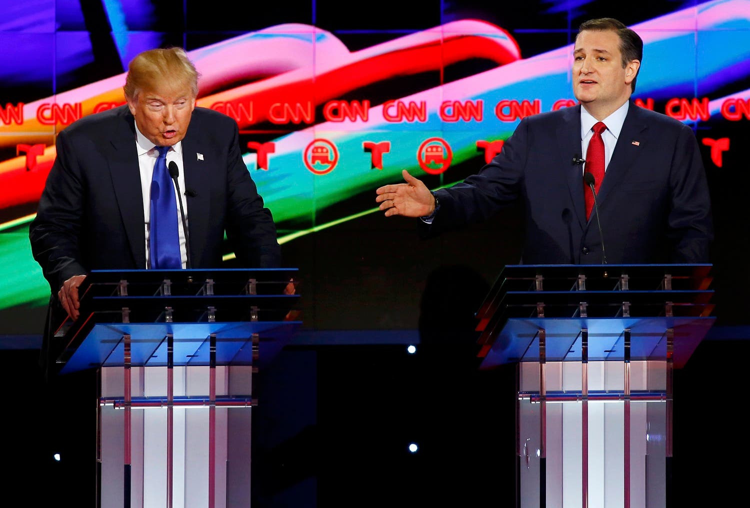 Republican U.S. presidential candidates Donald Trump (L) and Ted Cruz speak simultaneously as they discuss an issue during the debate sponsored by CNN for the 2016 Republican U.S. presidential candidates in Houston, Texas, February 25, 2016. REUTERS