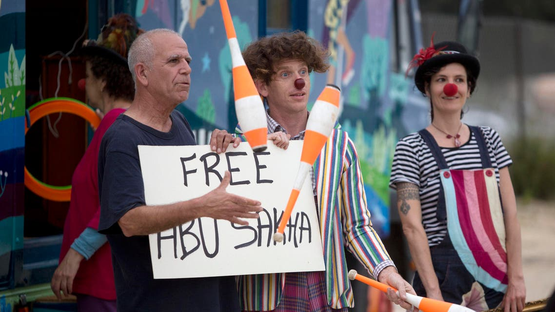 Israeli circus artists protest for the release of Palestinian detainee Abu Sakha, a circus performer on a 6-month administrative detention, outside the Megiddo prison northern Israel, Wednesday, March 2, 2016. (AP)
