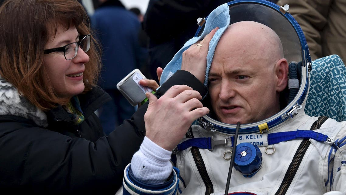U.S. astronaut Kelly is assisted by ground personnel shortly after landing near Dzhezkazgan. (Reuters)