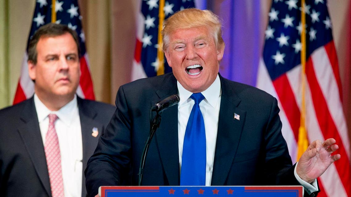 Republican presidential candidate Donald Trump, accompanied by New Jersey Gov. Chris Christie, left, speaks during a newsconference on Super Tuesday primary election night in the White and Gold Ballroom at The Mar-A-Lago Club in Palm Beach, Fla., Tuesday, March 1, 2016. (AP )