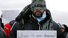 Iranian French camp protesters sew mouths shut