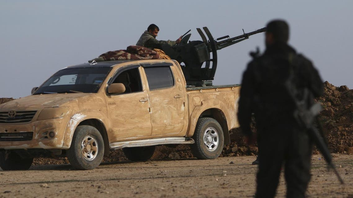 Fighters from the Democratic Forces of Syria position themselves in Ghazila village after taking control of the town from Islamic State forces in the southern countryside of Hasaka, Syria February 17, 2016. Picture taken February 17, 2016. REUTERS