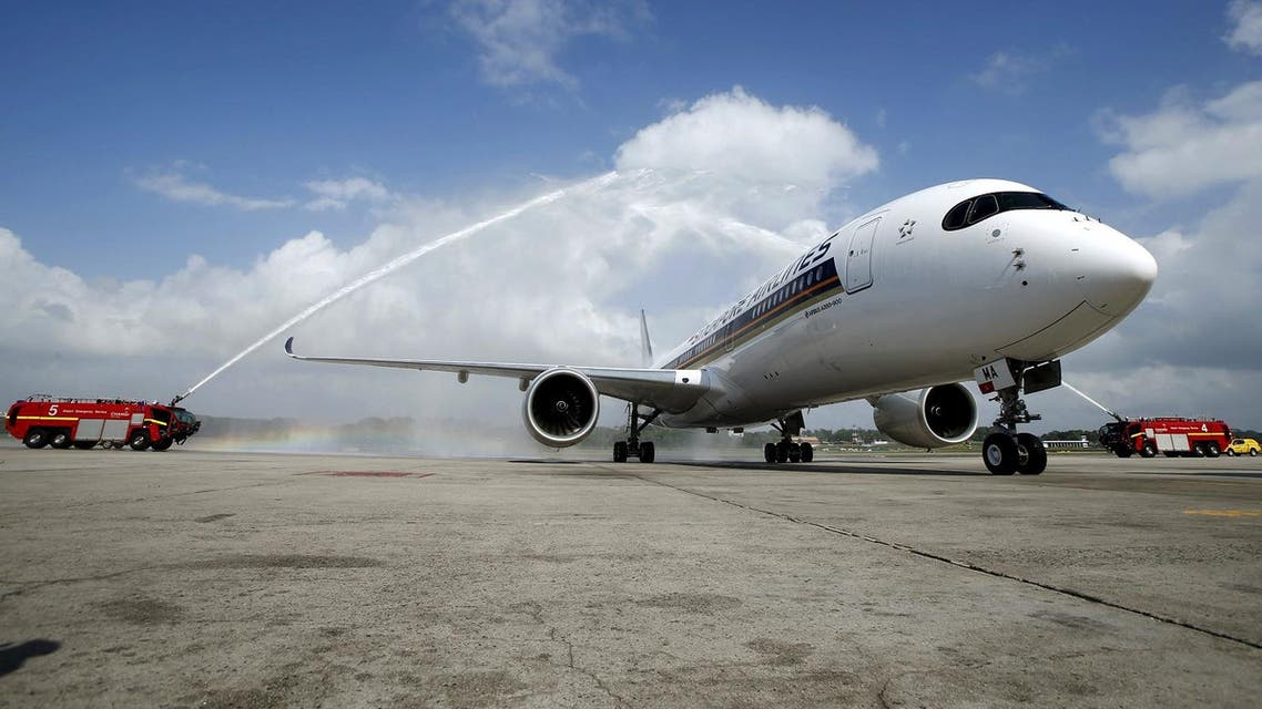 The first of 67 new Airbus A350-900 planes delivered to Singapore Airlines is greeted with a water cannon salute on arrival at Singapore's Changi Airport. (Reuters)