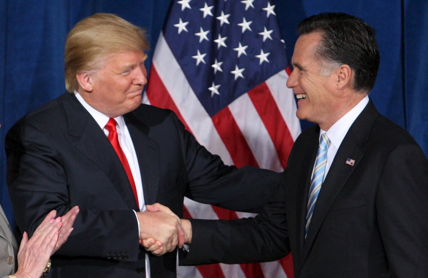 File photo of businessman and real estate developer Donald Trump greeting U.S. Republican presidential candidate and former Massachusetts Governor Romney after endorsing his candidacy for president at the Trump Hotel in Las Vegas. (Reuters)