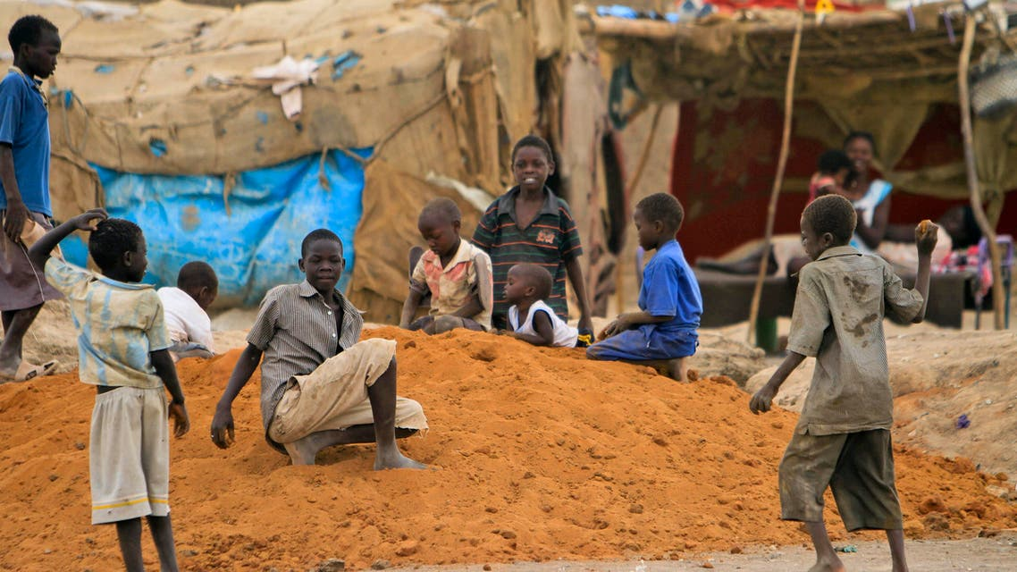 Children play outside their shelter during a visit by the UN Security Council delegation at the Mandela camp for displaced southern Sudanese, south of the capital Khartoum, in Sudan Sunday, May 22, 2011. AP