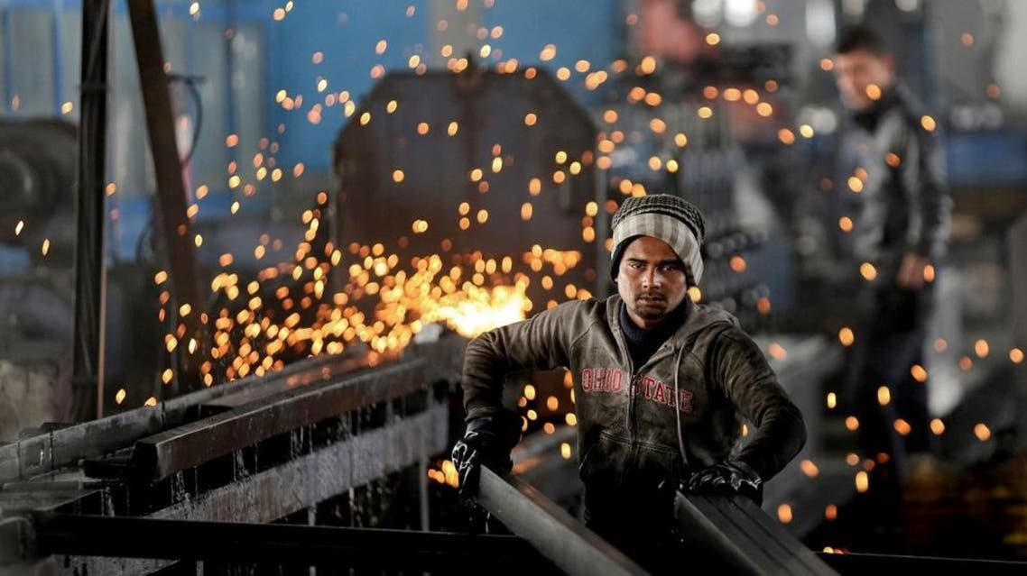 In this Thursday, Feb. 25, 2016 photo, a worker from India arranges steel tubes at a factory in the Muwaqer Industrial Estate, in northern Jordan (AP)