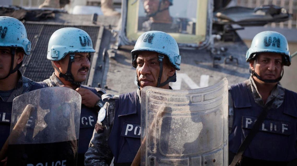UN peacekeepers from Jordan stand guard outside Parliament during a march by supporters of Senate President Jocelerme Privert for interim president in Port-au-Prince, Haiti, Saturday, Feb. 13, 2016. AP