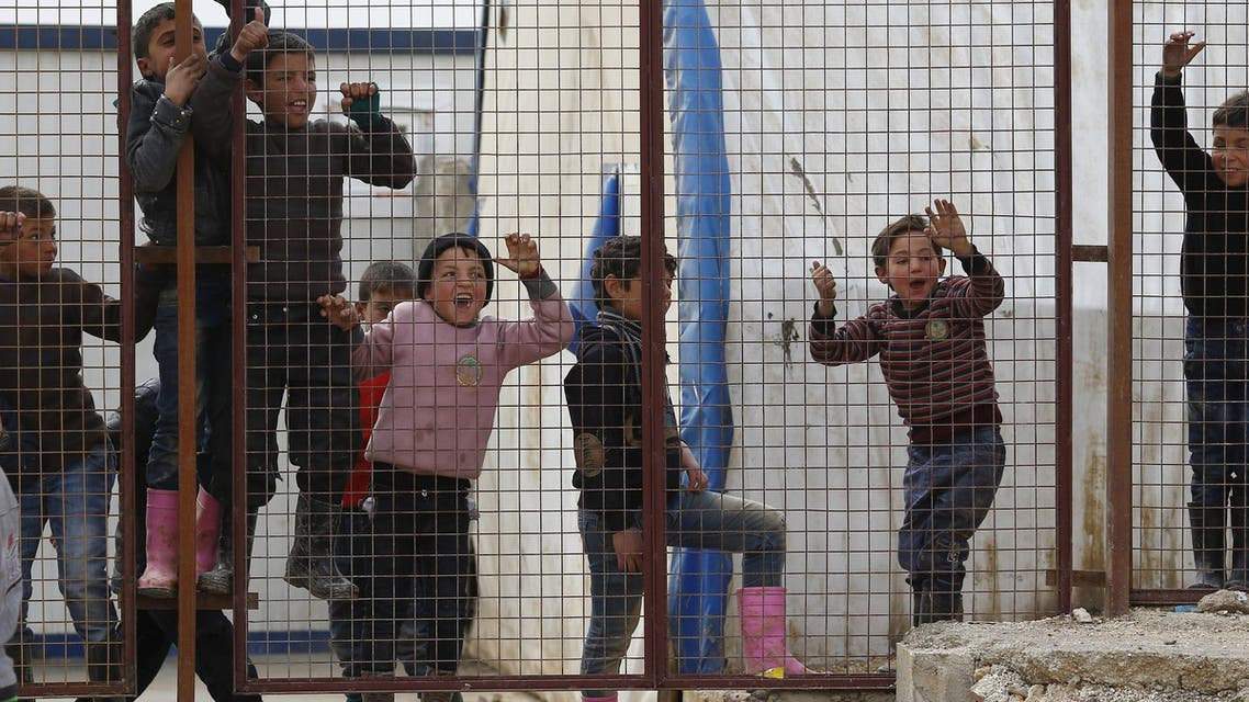 Internally displaced Syrian children play at a refugee camp near the Bab al-Salam crossing, across from Turkey's Kilis province, on the outskirts of the northern border town of Azaz, Syria February 6, 2016.  (Reuters)