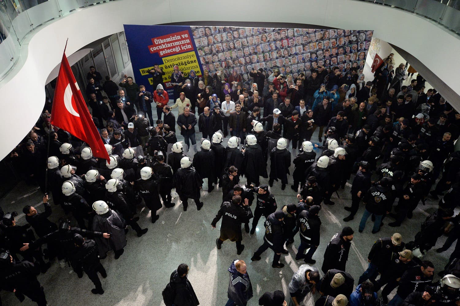 Riot police enter the headquarters of Zaman newspaper in Istanbul, late Friday, March 4, 2016 after a local court ordered that Turkey's largest-circulation, opposition newspaper, which is linked to a U.S.-based Muslim cleric, be placed under the management of trustees _ a move that heightens concerns over deteriorating press freedoms in Turkey. AP