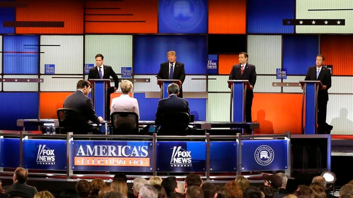 Republican presidential candidate, businessman Donald Trump, second from left, speaks as Sen. Marco Rubio, R-Fla., Sen. Ted Cruz, R-Texas, and Ohio Gov. John Kasich listen during a Republican presidential primary debate at Fox Theatre, Thursday, March 3, 2016, in Detroit. (AP)