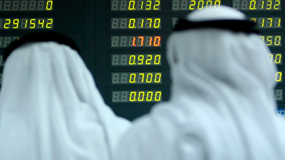 Bahraini traders watch the trading board at the Bahrain Stock Exchange in Manama, Bahrain. (AP)