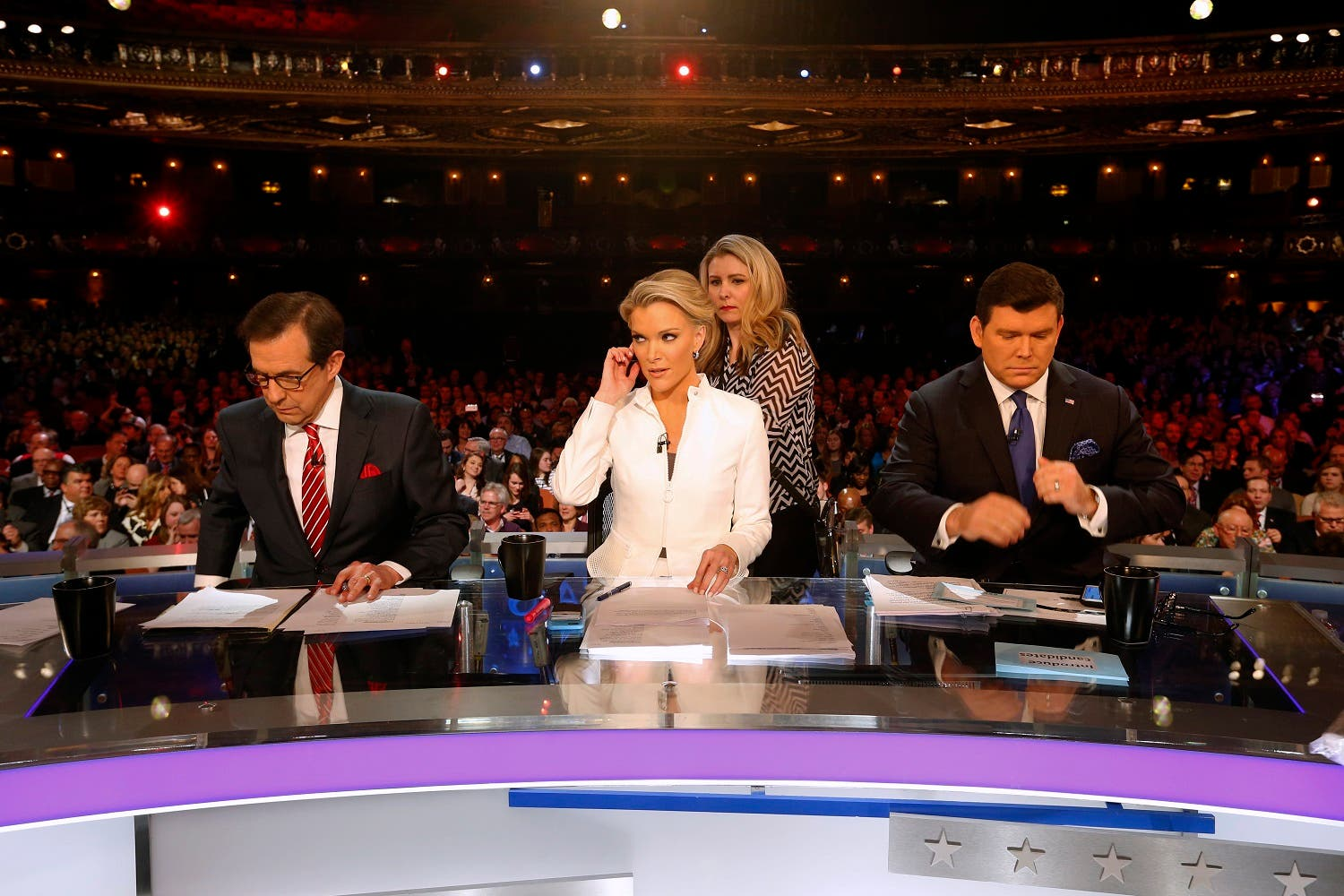 Moderators Bret Baier, Megyn Kelly and Chris Wallace take the stage before a Republican presidential primary debate at Fox Theatre, Thursday, March 3, 2016, in Detroit. (AP)
