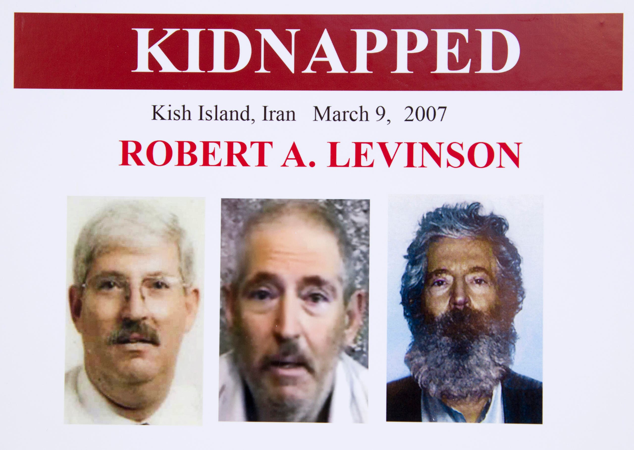 An FBI poster showing a composite image of retired FBI agent Robert Levinson, right, of how he would look like now after five years in captivity, and an image, center, taken from the video, released by his kidnappers, and a picture before he was kidnapped, left, displayed during a news conference in Washington, on March 6, 2012. (File photo: AP)