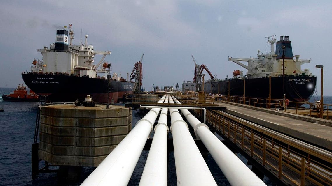 Two oil tankers, the Turkish Ottoman Dignity, right, and the Spanish Sandra Tapias, sit at Ceyhan oil terminal in this June 22, 2003 photo. Iraq began pumping fresh crude oil Wednesday, Aug. 13, 2003 through a pipeline to Ceyhan terminal for the first time since the war, a Turkish oil official said. (AP Photo/Burhan Ozbilici)
