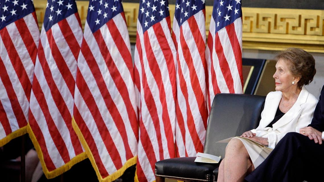 Former first lady Nancy Reagan sits in the Capitol Rotunda in Washington, Wednesday, June 3, 2009, during a ceremony to unveil a bronze statue of President Ronald Reagan. (AP Photo/Alex Brandon)