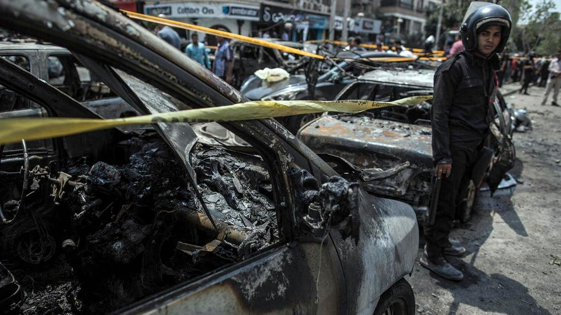 In this Monday, June 29, 2015 file photo, an Egyptian policeman stands guard at the site of a car bombing that killed Egypt's top prosecutor, Hisham Barakat, in Cairo, Egypt. The government is pushing through a new anti-terrorism draft bill that raised complaints that the government is taking advantage of the public's shock over last week's attacks, but it was also hailed by Egypt's political parties and other public figures as a much needed tool to combat violence that has been rising since the military ousted Islamist President Mohammed Morsi two years ago. (AP Photo/Eman Helal, File)