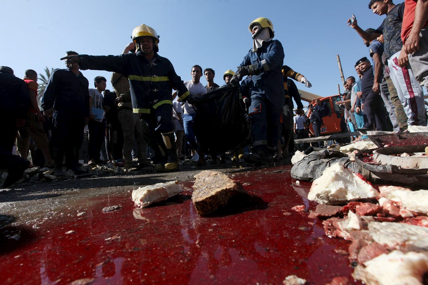 Blood is seen on the ground at the site of a bomb attack at a checkpoint in the city of Hilla, south of Baghdad, March 6, 2016. REUTERS/Alaa Al-Marjani