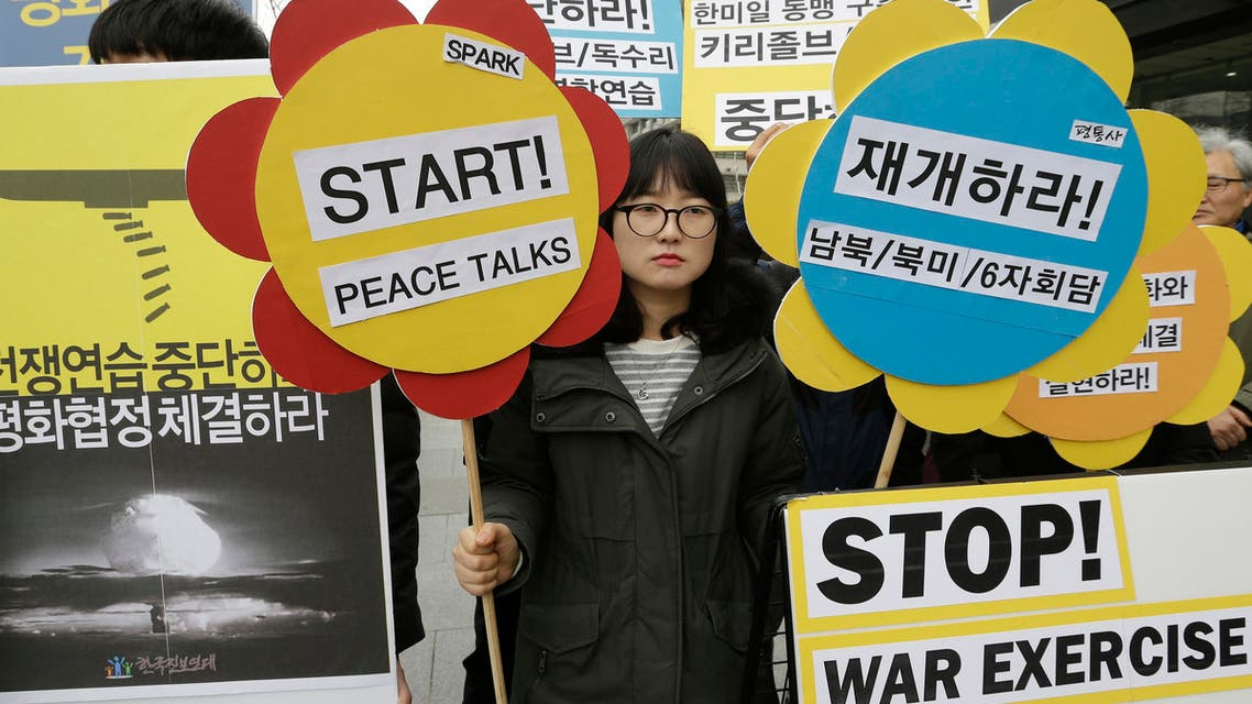 """An anti-war protester attends a rally opposing the joint military exercises, dubbed Key Resolve and Foal Eagle, between the US and South Korea near the US Embassy in Seoul, South Korea, on March 7. North Korea on Monday issued its latest belligerent threat, warning of an indiscriminate """"pre-emptive nuclear strike of justice"""" on Washington and Seoul, this time in reaction to the start of huge US-South Korean military drills. (AP)"""