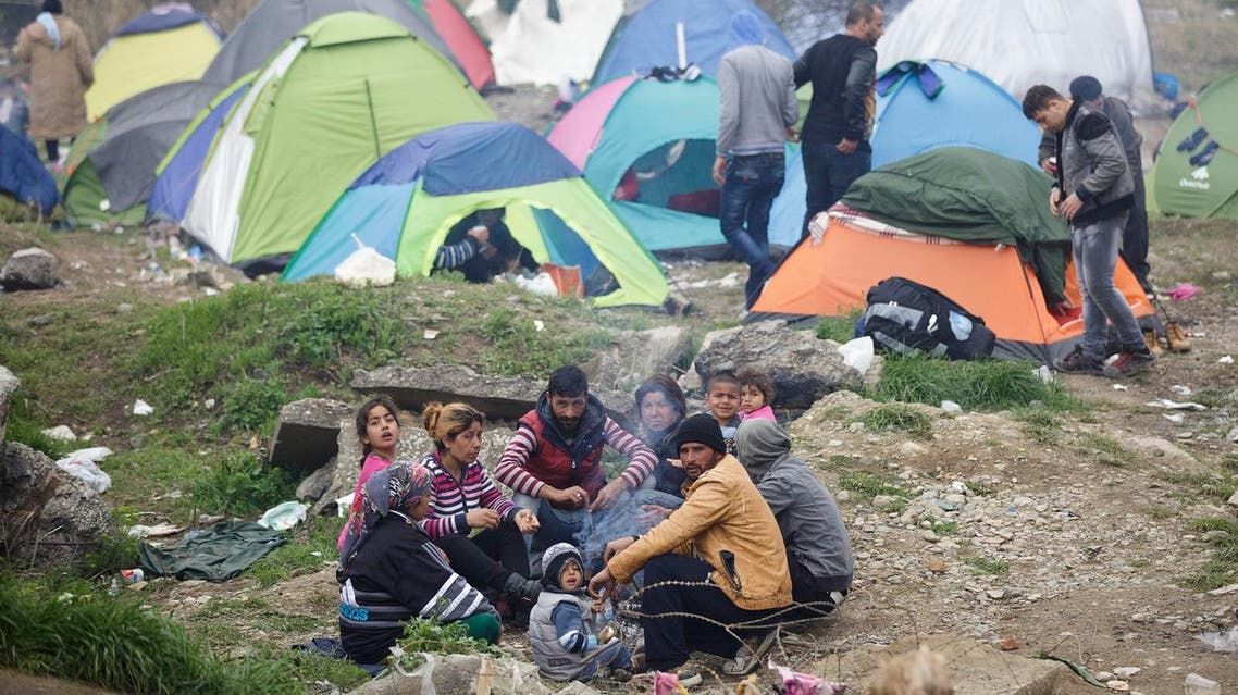 A migrant family gather around a fire, at the northern Greek border station of Idomeni, Monday, March 7, 2016  (Photo: AP)