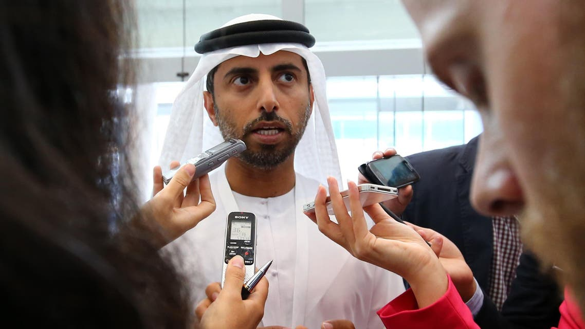 United Arab Emirates Oil Minister Suhail al-Mazroui (C) talks to journalists during the Global Aerospace Summit in Abu Dhabi, on March 7, 2016. / AFP