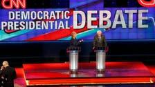Clinton and Sanders clash in Michigan debate