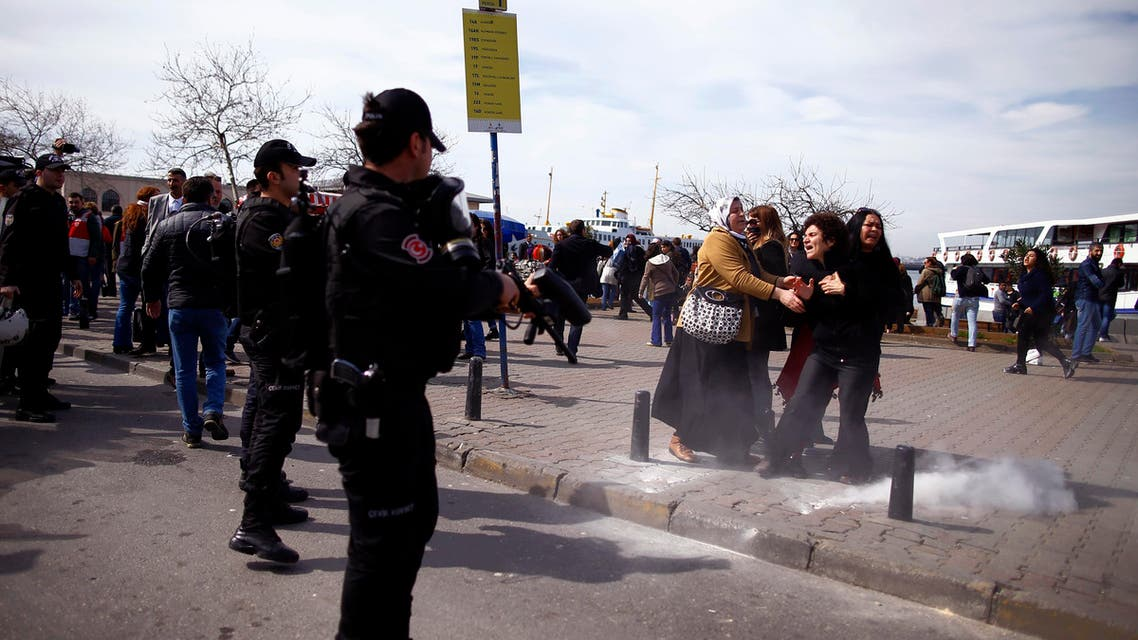 Riot police use tear gas to disperse women gathered to protest against the government and violence against women, prior to International Women's Day on Tuesday, in Kadikoy, Istanbul, Sunday, March 6, 2016.(AP)