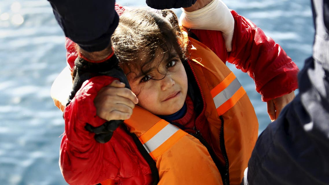 Greek Coast Guard officers move a girl from a dinghy carrying refugees and migrants aboard the Ayios Efstratios Coast Guard vessel, during a rescue operation at open sea between the Turkish coast and the Greek island of Lesbos, February 8, 2016. (Reuters)