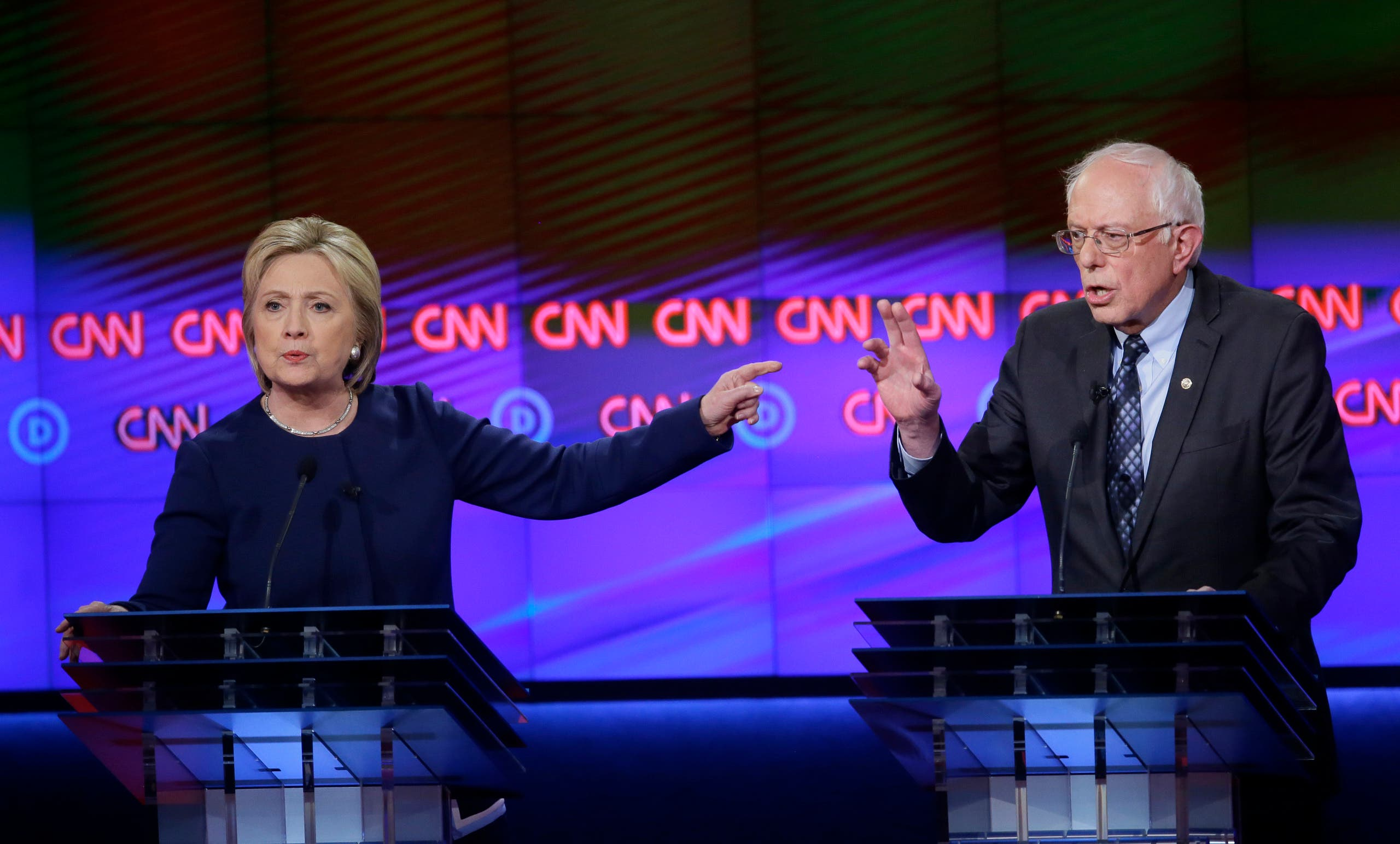 Hillary Clinton and Bernie Sanders argue during the Democratic presidential primary debate at the University of Michigan-Flint on March 6. (AP)