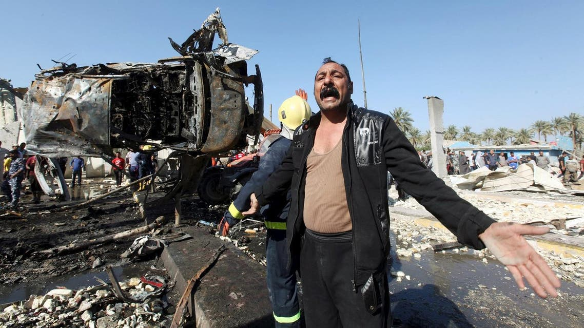 A man reacts at the site of a bomb attack at a checkpoint in the city of Hilla, south of Baghdad, March 6, 2016. REUTERS/Alaa Al-Marjani TPX IMAGES OF THE DAY